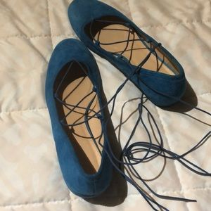 Blue suede strap up shoes